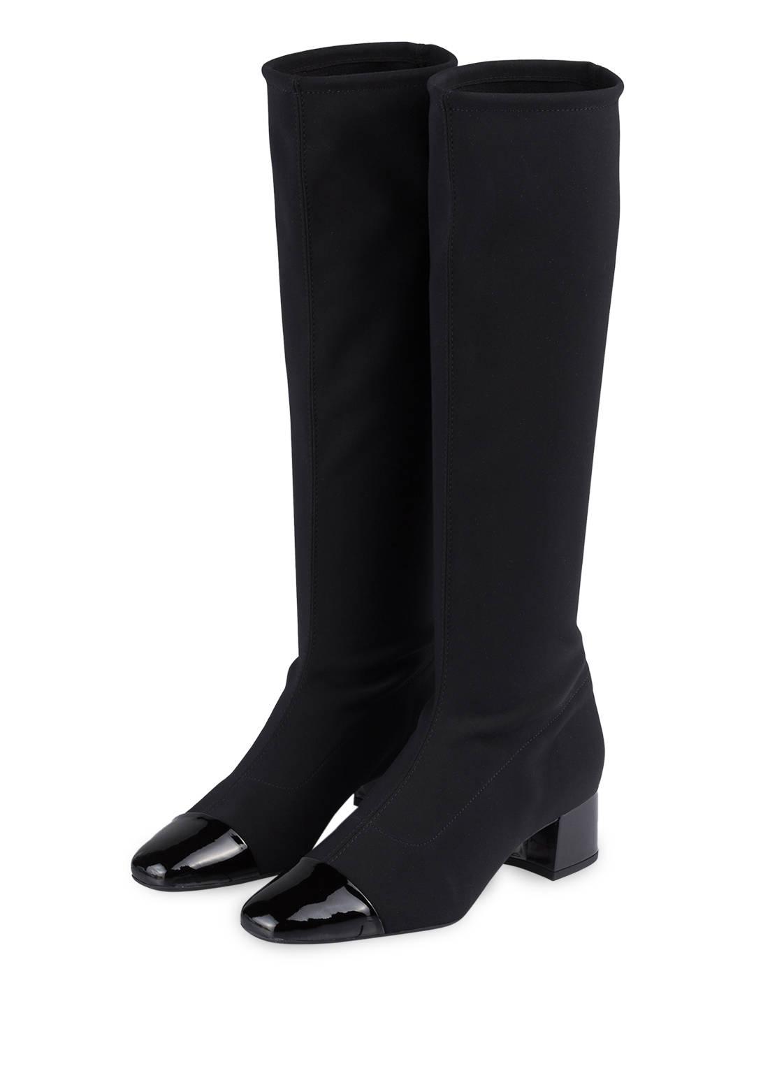 Artikel klicken und genauer betrachten! - So classy: Die Stiefel TINJA von PETER KAISER verbinden elegantes Design mit einem hochkomfortablen Tragegefühl. Das Duo präsentiert sich mit einem elastischen, schmalen Schaft und Ziernähten am Fußbereich. Einsätze von Lackleder an der Kappe und am Absatz setzen willkommene Akzente. Überzeugen Sie mit schlichter Eleganz! Details: Textil und Lackleder. Lack-Kappe in Karree-Form. Elastischer, schmaler Schaft. Ziernähte am Fußbereich. Überzogener Blockabsatz. - Schaftweite: 35 cm- Schafthöhe: 42 cm- Absatzhöhe: 4,5 cm Der Artikelversand kostet soweit nicht anders angegeben 3.95 € und der Artikel gehört zur Kategorie: Schuhe. | im Online Shop kaufen