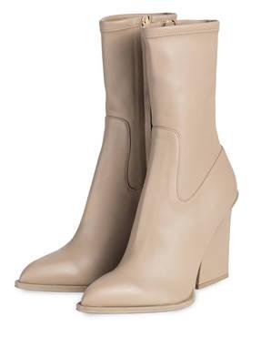 Wie braune Stiefel mit grauer Hose zu kombinieren (166